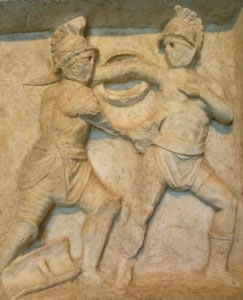 Escultura en relieve de dos guerreros luchando