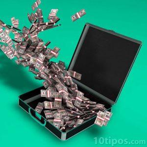 Billetes entrando a un maletín negro